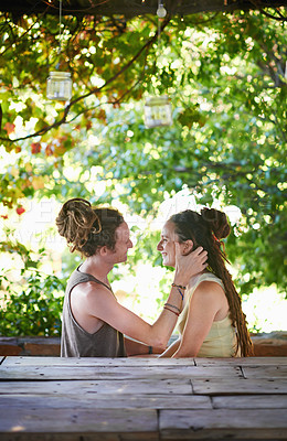 Buy stock photo A cute young couple spending time together outdoors