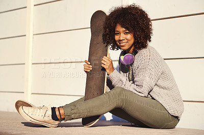 Buy stock photo Shot of a young woman in a skate park
