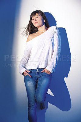 Buy stock photo Shot of an attractive brunette female in casual clothes posing on white background