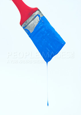 Buy stock photo Closeup of a paintbrush with blue paint dripping off isolated on white