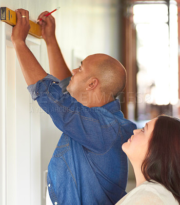 Buy stock photo Shot of a married couple doing some improvements on their home