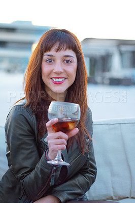 Buy stock photo Shot of a beautiful woman holding an alcoholic beverage