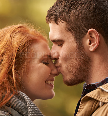 Buy stock photo A cute couple kissing outdoors