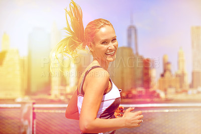 Buy stock photo Shot of an attractive blonde woman enjoying a run in the city