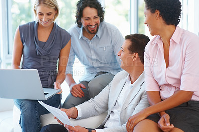 Buy stock photo Team of corporate professionals having friendly discussion