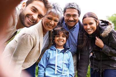 Buy stock photo Shot of a multi-generational family posing for a self-portrait