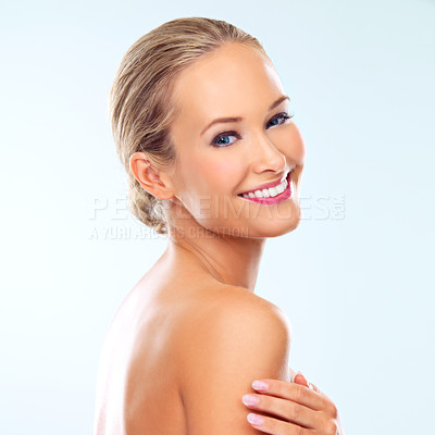 Buy stock photo Studio shot of a beautiful young woman with perfect skin against a blue background