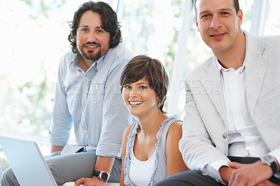 Buy stock photo Three business people smiling and working at office