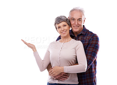 Buy stock photo Studio portrait of an affectionate elderly couple isolated on white
