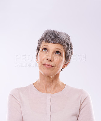 Buy stock photo Studio shot of a thoughtful mature woman against a white background