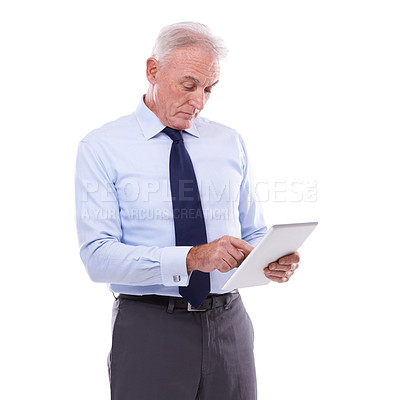 Buy stock photo Studio shot of a mature man working on a digital tablet isolated on white