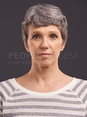 Buy stock photo Studio portrait of an elderly woman against a gray background