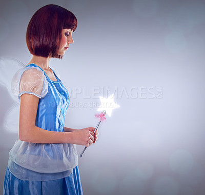Buy stock photo A cropped shot of a fairy godmother in a blue gown
