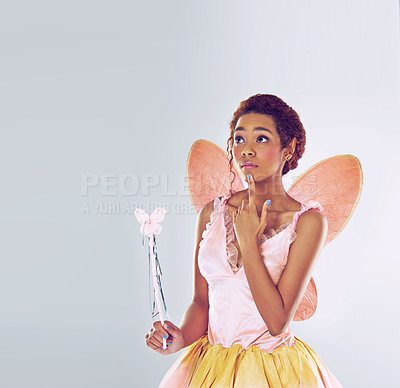 Buy stock photo A cropped shot of a cute fairy looking thoughtful