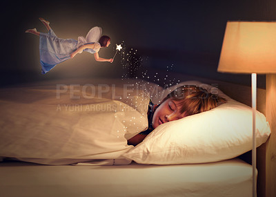 Buy stock photo Shot of a young boy sleeping peacefully while a fairy hovers above him