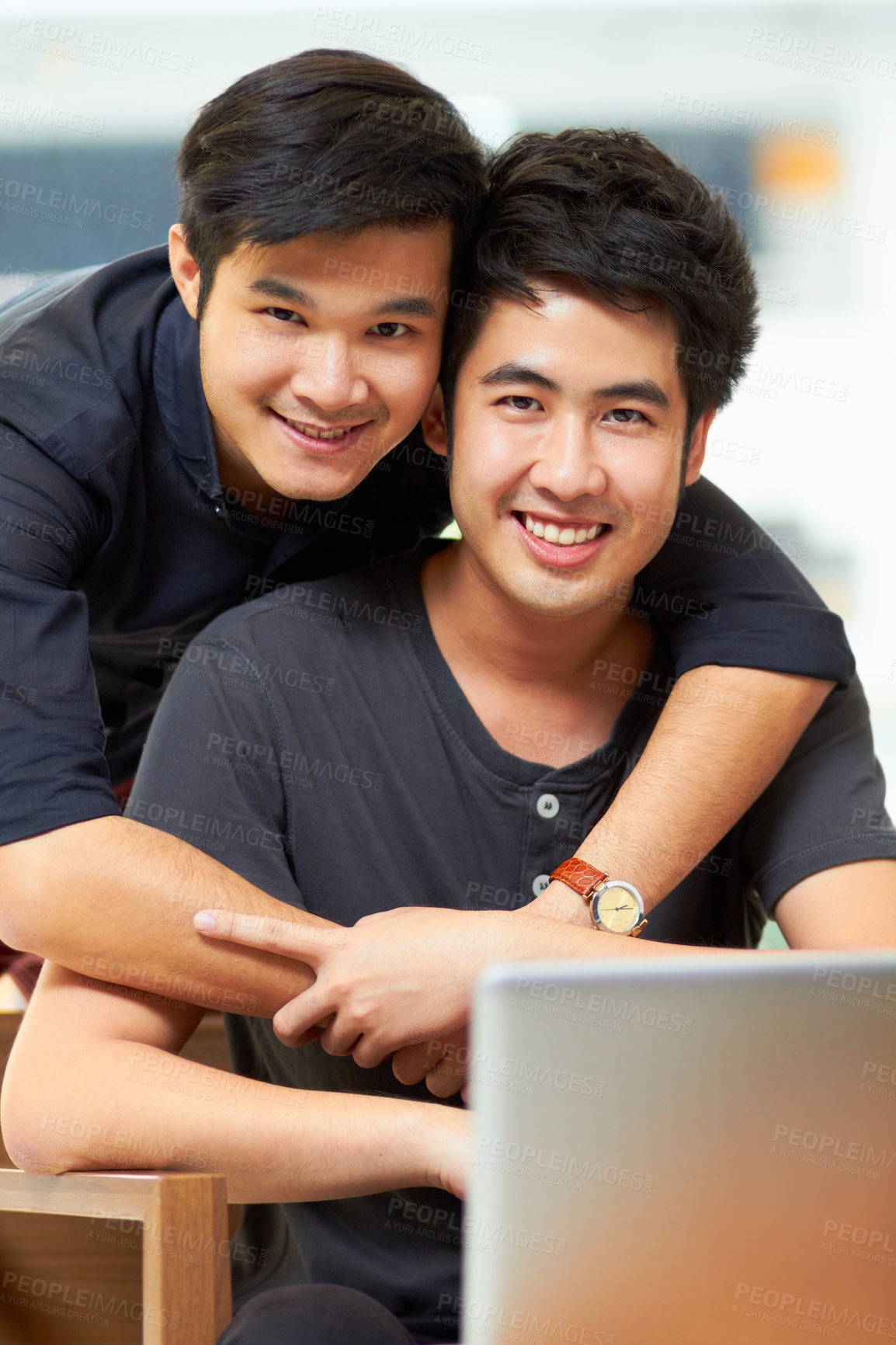 Buy stock photo Portrait of an affectionate young gay couple relaxing at home with a laptop