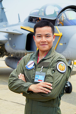 Buy stock photo A shot of a confident asian fighter pilot