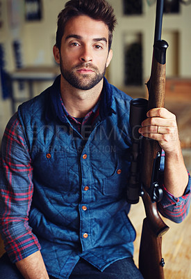 Buy stock photo Portrait of a hunter posing with his rifle