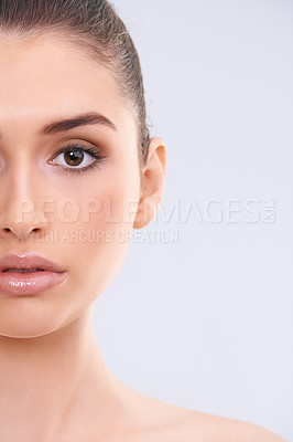 Buy stock photo Cropped studio portrait of a beautiful young woman with flawless skin