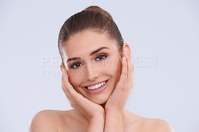 Buy stock photo Studio portrait of a beautiful young woman posing with her head in her hands