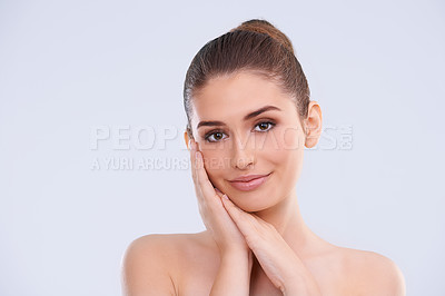 Buy stock photo Studio portrait of a beautiful young woman with flawless skin