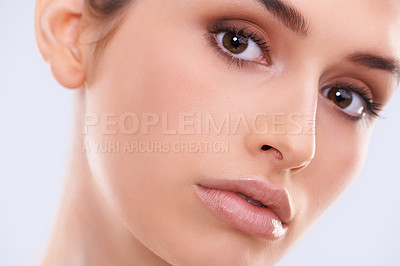 Buy stock photo Closeup studio portrait of a beautiful young woman with flawless skin