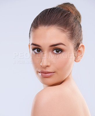 Buy stock photo Studio shot of a beautiful young woman with flawless skin looking over her shoulder