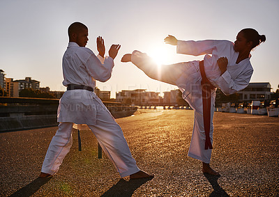 Buy stock photo Two sportspeople facing off and practicing their karate while wearing gi