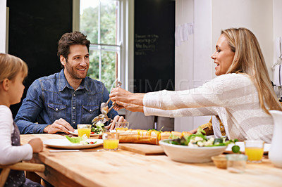 Buy stock photo A family sitting down to eat dinner together