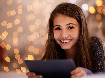 Buy stock photo Portrait of a cute little girl using a digital tablet