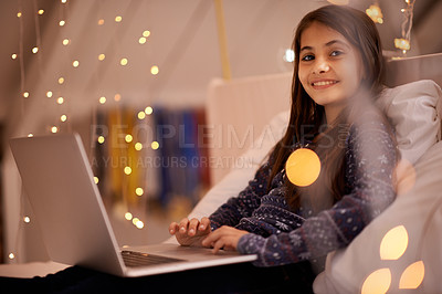 Buy stock photo Portrait of a cute little girl using a laptop at home
