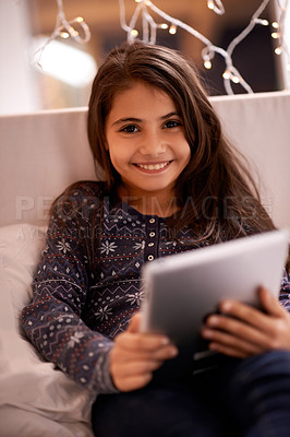Buy stock photo Portrait of a happy little girl using her digital tablet
