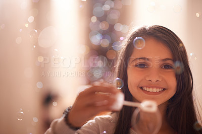 Buy stock photo Portrait of a cute little girl blowing bubbles
