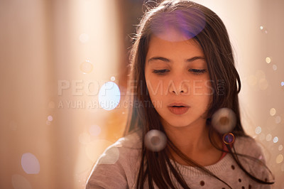 Buy stock photo Shot of a cute little girl blowing bubbles