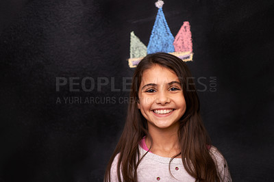 Buy stock photo Portrait of a young girl standing in front of a chalkboard drawing of a crown
