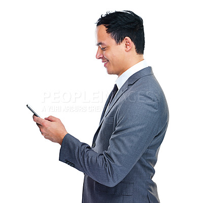 Buy stock photo Studio shot of a young businessman holding a cellohone