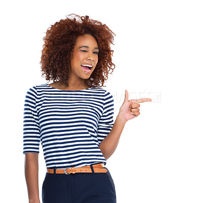 Buy stock photo Studio shot of a beautiful young woman pointing to copyspace