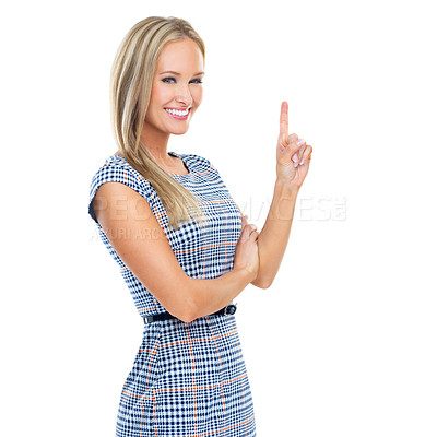 Buy stock photo Cropped studio portrait of a beautiful young woman pointing up at copyspace