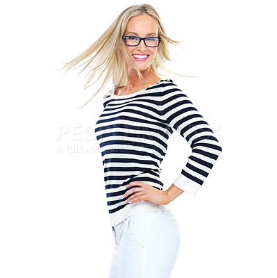 Buy stock photo Studio shot of a beautiful young woman flinging her blonde hair against a white background