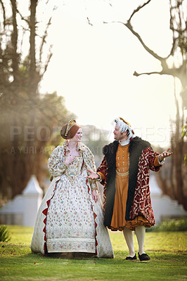 Buy stock photo Shot of a royal couple spending time together at the gardens