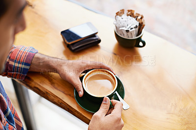 Buy stock photo Cropped shot of a young man in a coffee shop