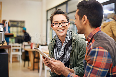 Buy stock photo Cropped shot of a young couple using a digital tablet together