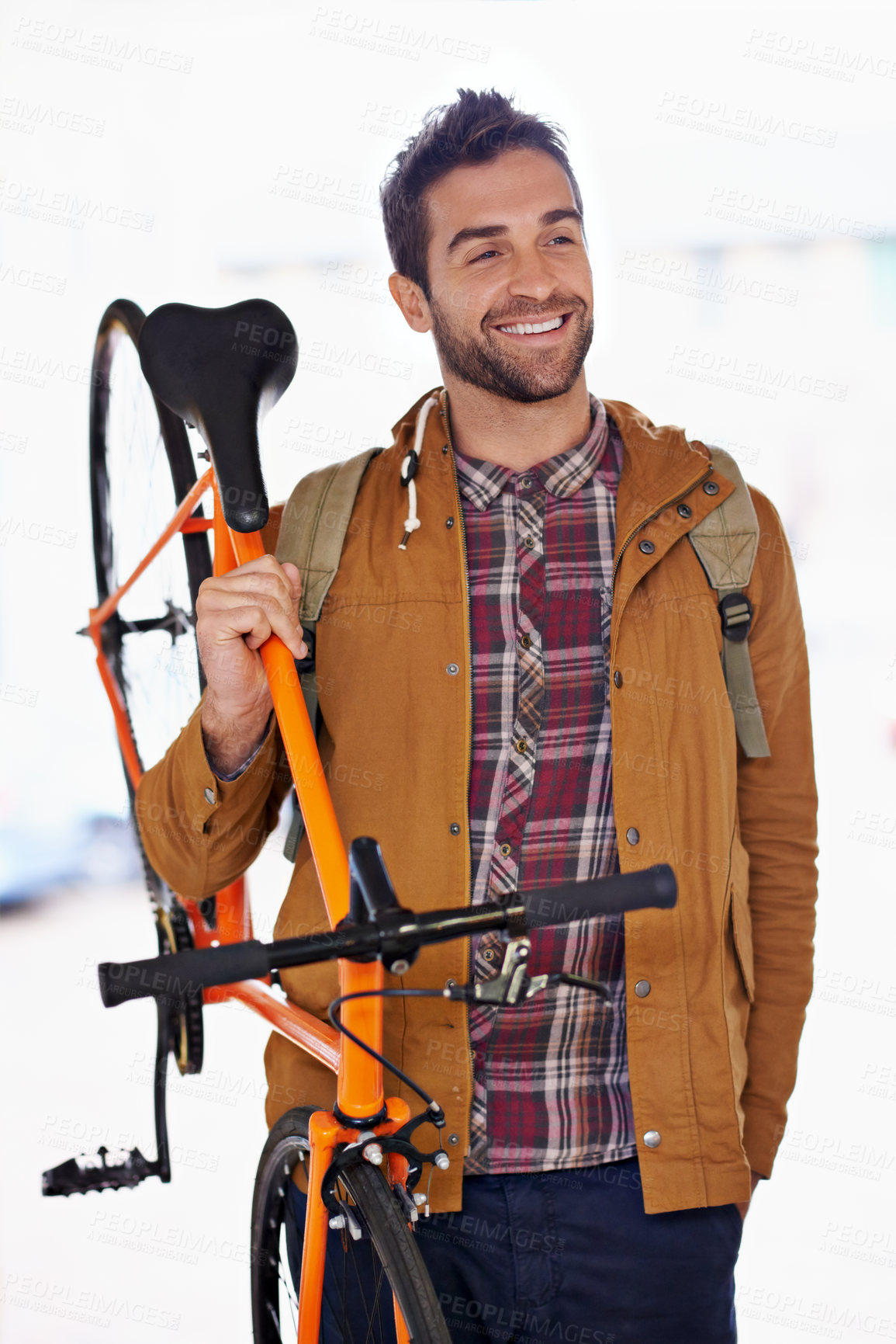 Buy stock photo Cropped shot of a handsome young man walking with his bicycle