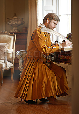 Buy stock photo Shot of an aristocratic man at his writing table