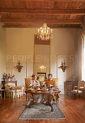 Buy stock photo Shot of a noble couple eating together