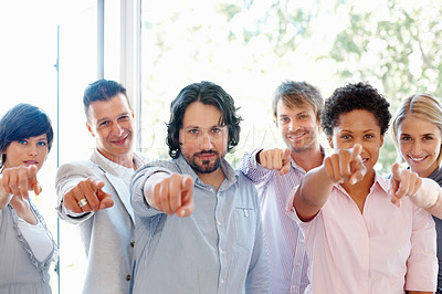 Buy stock photo Multi ethnic business team pointing at you