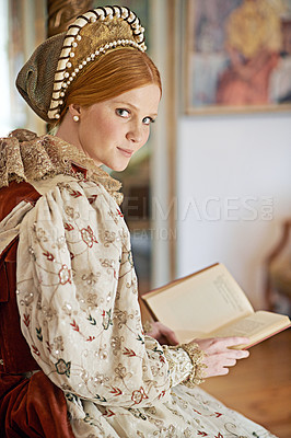Buy stock photo Portrait of an elegant noble woman reading in her palace room