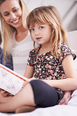 Buy stock photo Portrait of a little girl reading to her mother and brother