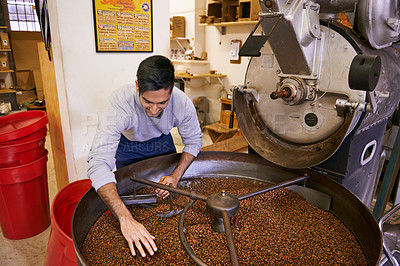 Buy stock photo Shot of a young man working with raw coffee beans