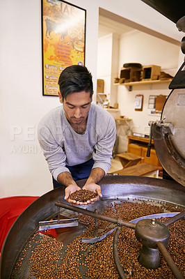 Buy stock photo Shot of a machine grinding and roasting coffee beans